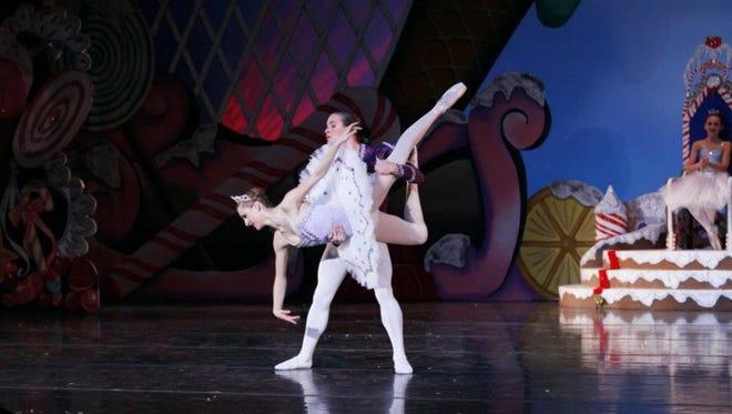 Simon Pawlak catches a sugar plum fairy in a 2008 performance of The Nutcracker.