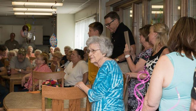 Lenore Ehlers, 99, is surprised by police and peers by a birthday party.