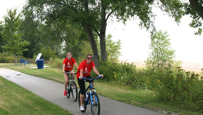 Two women participate in the 2014 Ride For Hunger event that raised about $3,000 for the Manitowoc County Salvation Army.