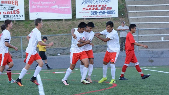 Erwin soccer players congratulate Jesus Cruz-Damian after a goal earlier this season.