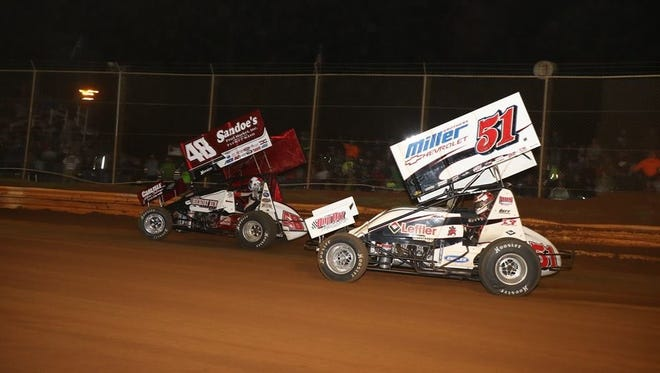 Stevie Smith (51) chases Danny Dietrich during the Dirt Classic at Lincoln Speedway on Saturday. Smith came away with the $20,000 victory.