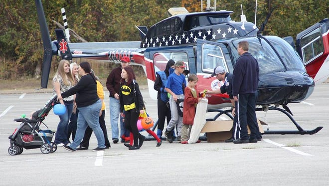 Helicopters, fire trucks, police cars and more pass out candy at the annual Jackson-Madison County Trunk or Treat.
