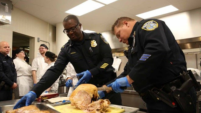 Milwaukee police officers join with MATC and Messmer High School students to cook for an upcoming community Thanksgiving meal.