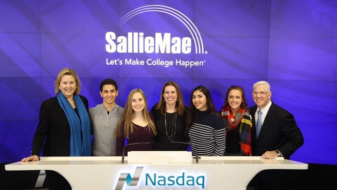 Sallie Mae executives and Bridging the Dream scholarship winners ring the bell at NASDAQ on December 12. Pictured (left to right) are  Martha Holler, senior vice president, Sallie Mae Quinton Lopez of Canoga Park, California Kayla Pinzur of Brewster, New York Liz Robinson, vice president, Sallie Mae Bryana Blanco of Pembroke Pines, Florida Kendal Cooney, of Camden, Michigan Charlie Rocha, executive vice president, Sallie Mae