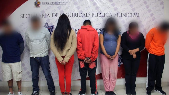 Juárez police arrested seven people suspected in 11 homicides in the past three months. Authorities blurred out their faces per rules regarding the identification of crime suspects.