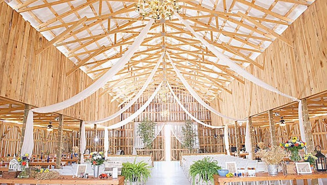 Inside of the wedding barn at Red River Farms in Springfield.