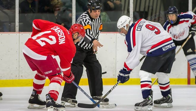 A face-off at the annual charity hockey game between the Westland Wild Wings and the Detroit Red Wings alumni team.