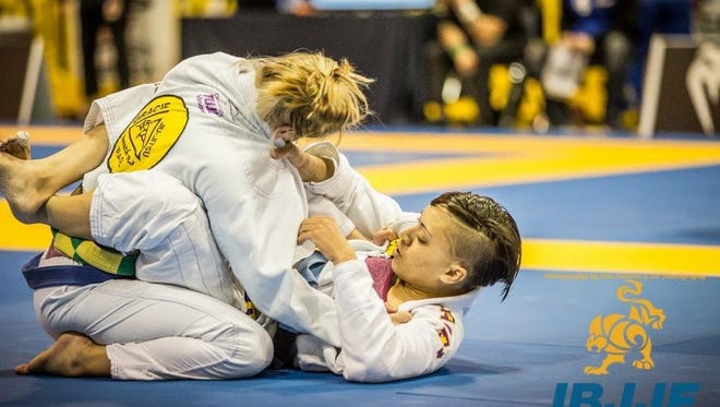 Malanie Camden, bottom, and Laura Christian will represent The Academy of Pensacola at the IBJJF World Championships in Long Beach, California on June 2.