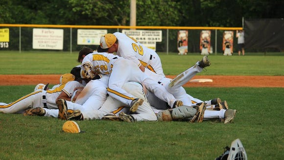Murphy baseball players celebrate after winning the