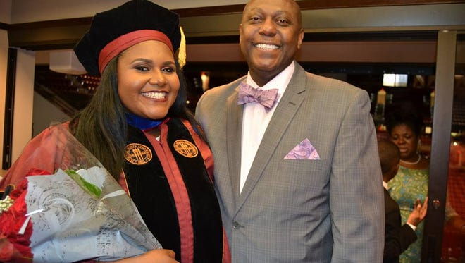 Dr. Lataisia C. Jones and her father celebrate her graduation.