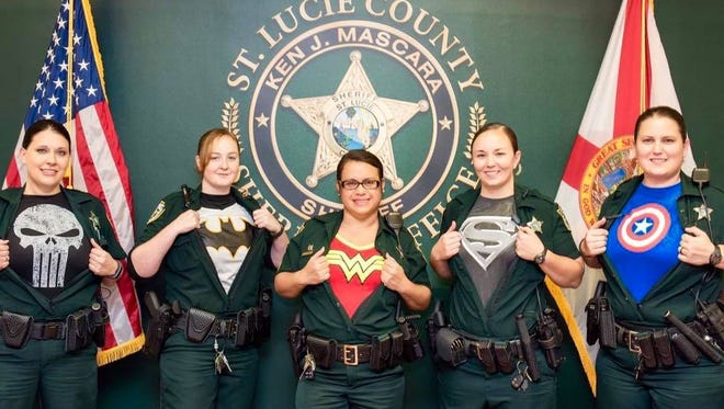 "The St. Lucie County Sheriff's Office showed off its ""superheroes"" on Facebook on Friday, asking for donations to the Treasure Coast Food Bank."