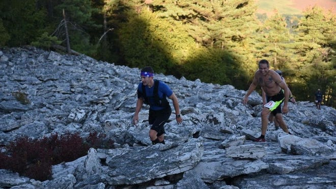 Saint Thomas' Ryan Kaczmark, left, and Chambersburg's Rick Myers take on the Boulder Beast, a 27-mile race with more than 7,000 feet of elevation, on Sept. 23.