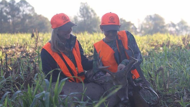 Haley Heath with her son Gunner and his 7-point deer are seen in this Gleaner file photo.