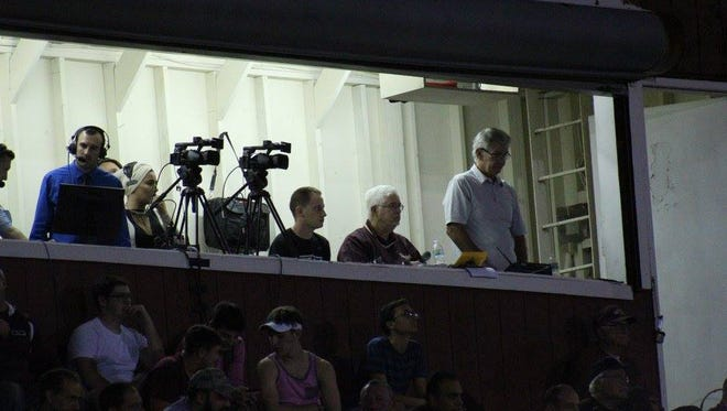 Ernie Mezey (second from right) has been the public address announcer at Wayne Hills for 18 seasons.