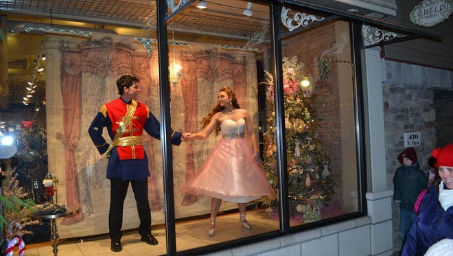 Some seasonal store windows in Milford feature live models.