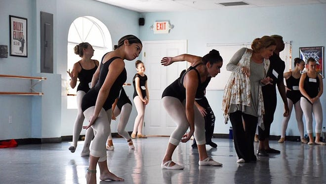 Students practicing for South Florida Dance Company's 6th Annual Production of 'A Christmas Carol' with instructor Tara Anstensen.