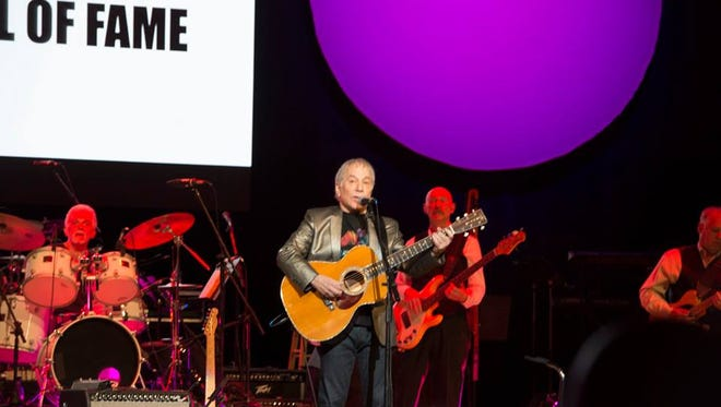 Paul Simon performing with Rochester Music Hall of Fame 2018 inductees Steve Gadd and Tony Levin on April 22 at Eastman Theatre.
