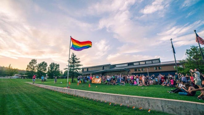 The rainbow flag is raised on the lawn of Flagstaff City Hall during Pride in the Pines.