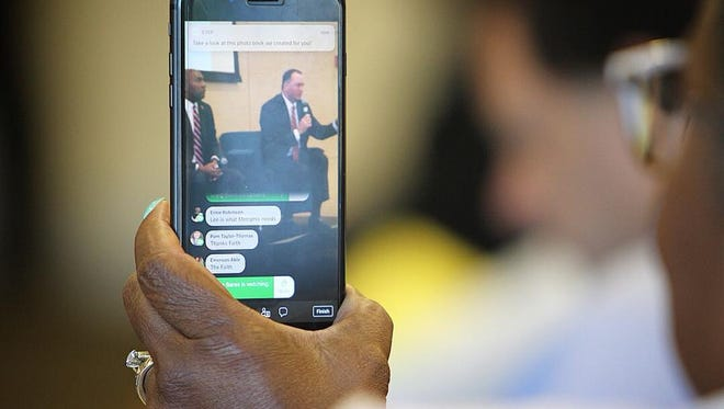 Around 150 filled the room at the National Civil Rights Museum Tuesday night, taking notes and using social media to document the candidate's words.