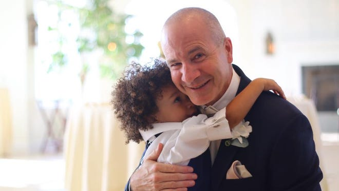 Tim Wesley and his grandson Mason