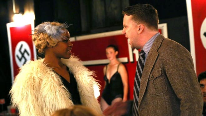 "Kamillah Camp-Bey, as Sally Bowles, and Charlie Reese, as Cliff Bradshaw, in Des Moines Onstage's ""Cabaret"" at the Des Moines Social Club."