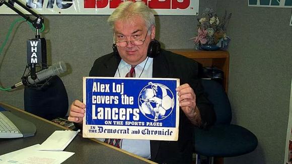 "Alex Loj, pictured in studio on ""The Bob Matthews Show,"" died on Saturday in Florida."
