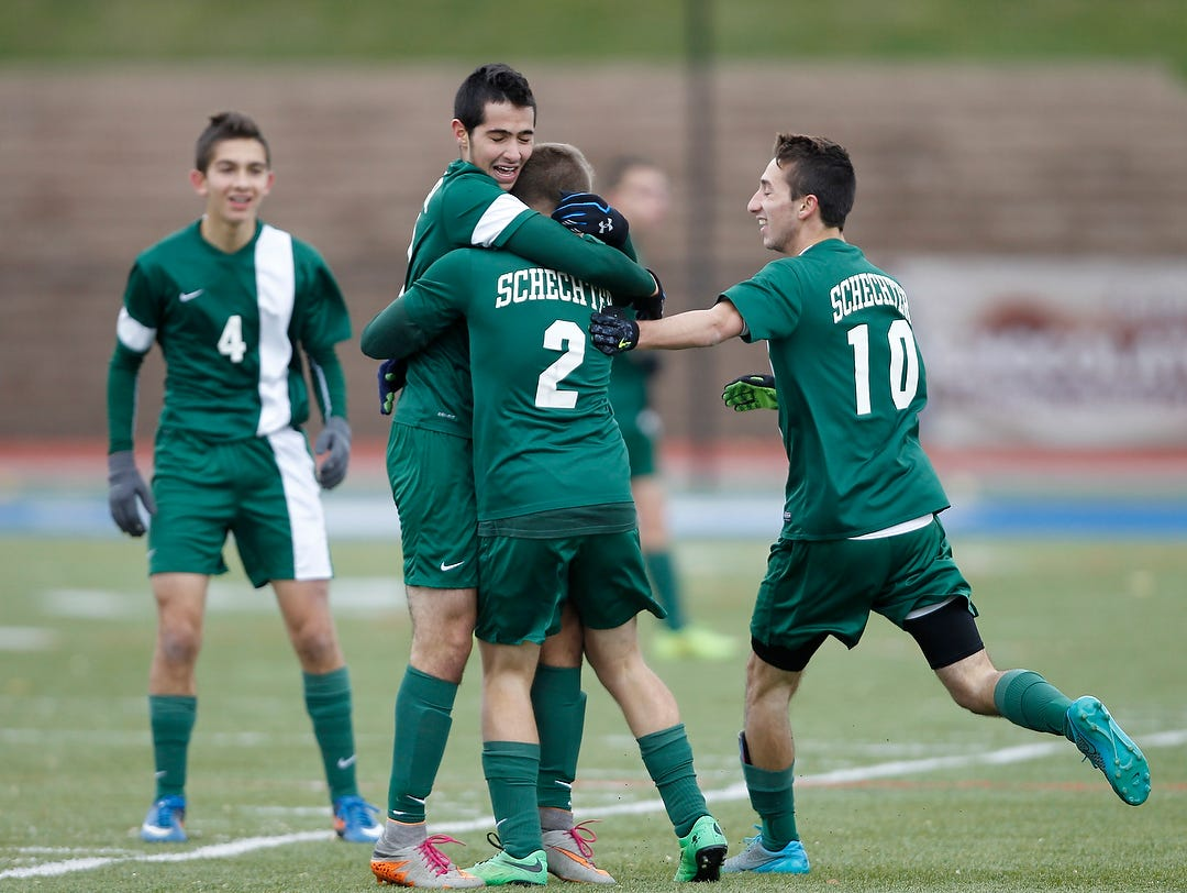 Solomon Schechter players react to their goal during their 1-0 win over Geneseo in the NYSPHSAA Class C state semifinal soccer game at Middletown High School on Saturday, Nov. 14, 2015.