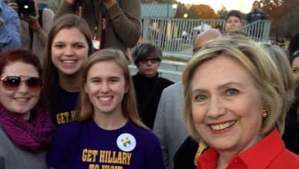 Keota High School students Kylea Tinnes, left, Megan Adam, center, and Abby Schulte greet Hillary Clinton at a campaign event in Coralville Nov. 3.