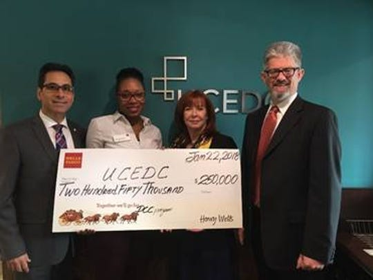 From left:Tomas Porturas, vice president of Wells Fargo Community Relations; Tashana Bisumber, branch manager at Wells Fargo Cranford branch location; Maureen Tinen, president of UCEDC; and Adam Farrah, vice president of UCEDC.