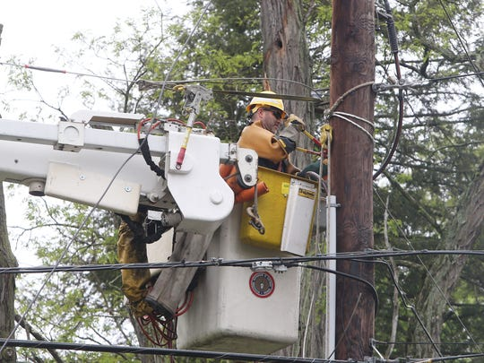 Todd Felton, a Central Hudson lineman works to repair damaged utility lines on Baxtertown Road in Fishkill on May 17, 2018.