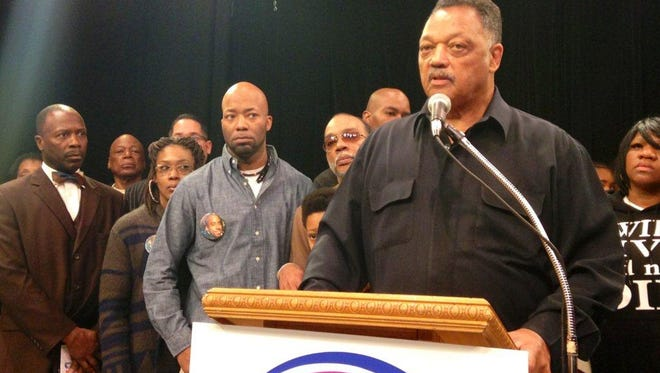 The Rev. Jesse Jackson is joined Saturday, Dec. 27, 2014,  by relatives and other supporters of Dontre Hamilton, a Milwaukee man shot and killed by a former city police officer, at a rally at Jackson's Rainbow PUSH Coalition headquarters in Chicago. Jackson said he will continue to try to draw attention to the case. Standing third from left, wearing a button of Hamilton is his brother Dameion Perkins.