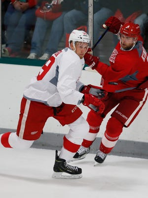 Detroit Red Wings Anthony Mantha, left, and Jakub Kindl scrimmage at training camp Sept. 18, 2015, in Traverse City.