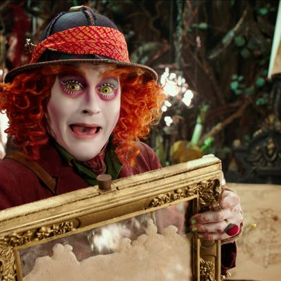 """Johnny Depp portrays the Hatter in a scene from """"Alice Through The Looking Glass."""""""