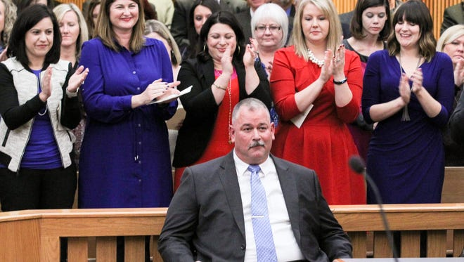 David Wagner, 10th Judicial Circuit solicitor, gets applause from a crowd of 150 friends, family, supporters and officials Wednesday after an oath of office ceremony in the Anderson County Courthouse in Anderson.
