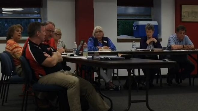 The Sevastopol School Board listens during the public comment portion of its meeting Thursday.