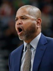 Memphis Grizzlies head coach J.B. Bickerstaff shouts to his team in the first half during an NBA basketball game against the Utah Jazz Friday, March 30, 2018, in Salt Lake City. (AP Photo/Rick Bowmer)