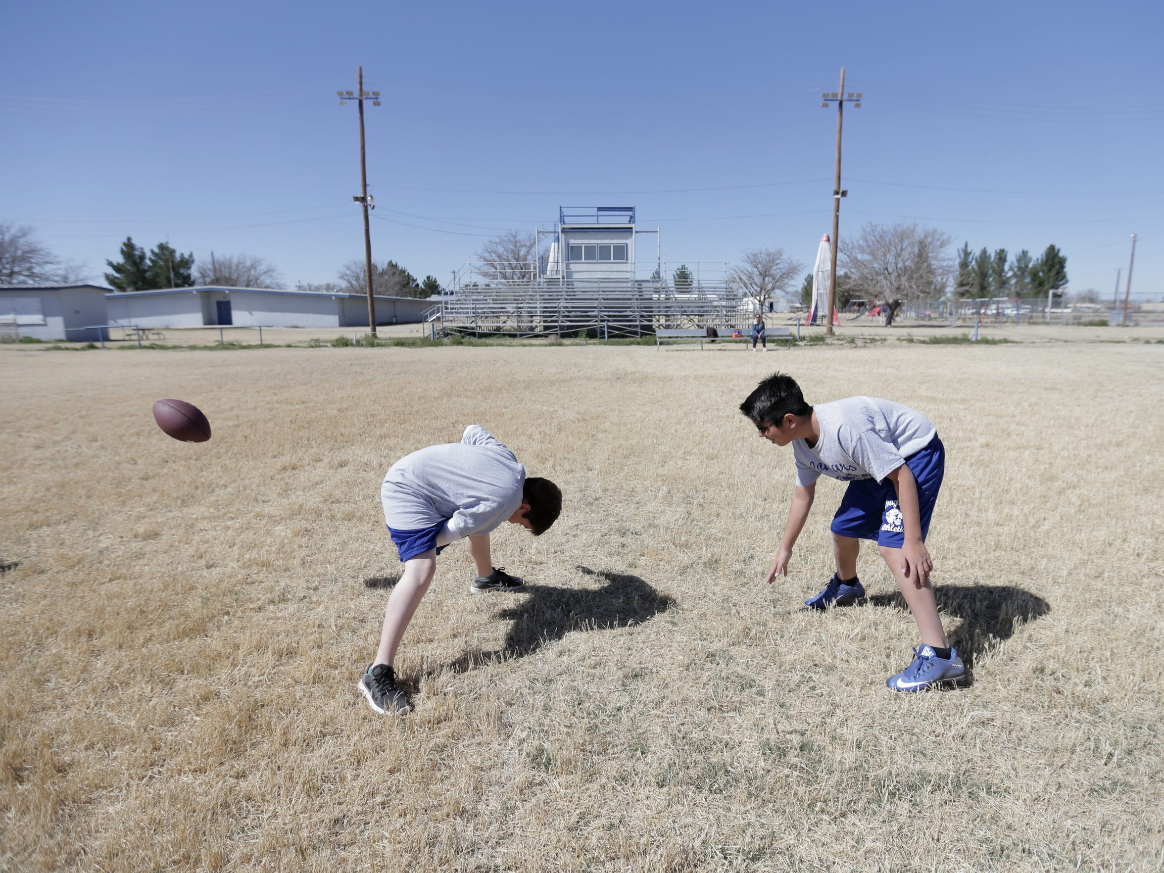 Kids play football during PE at Dell City School. Dell City Superintendent Fabian J. Gomez said there was once an 11-man football team at the school but they now play six-man football. Last year the team couldn't even field a six-man team.