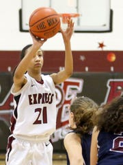 Zaria Thomas of Elmira shoots from the top of the key