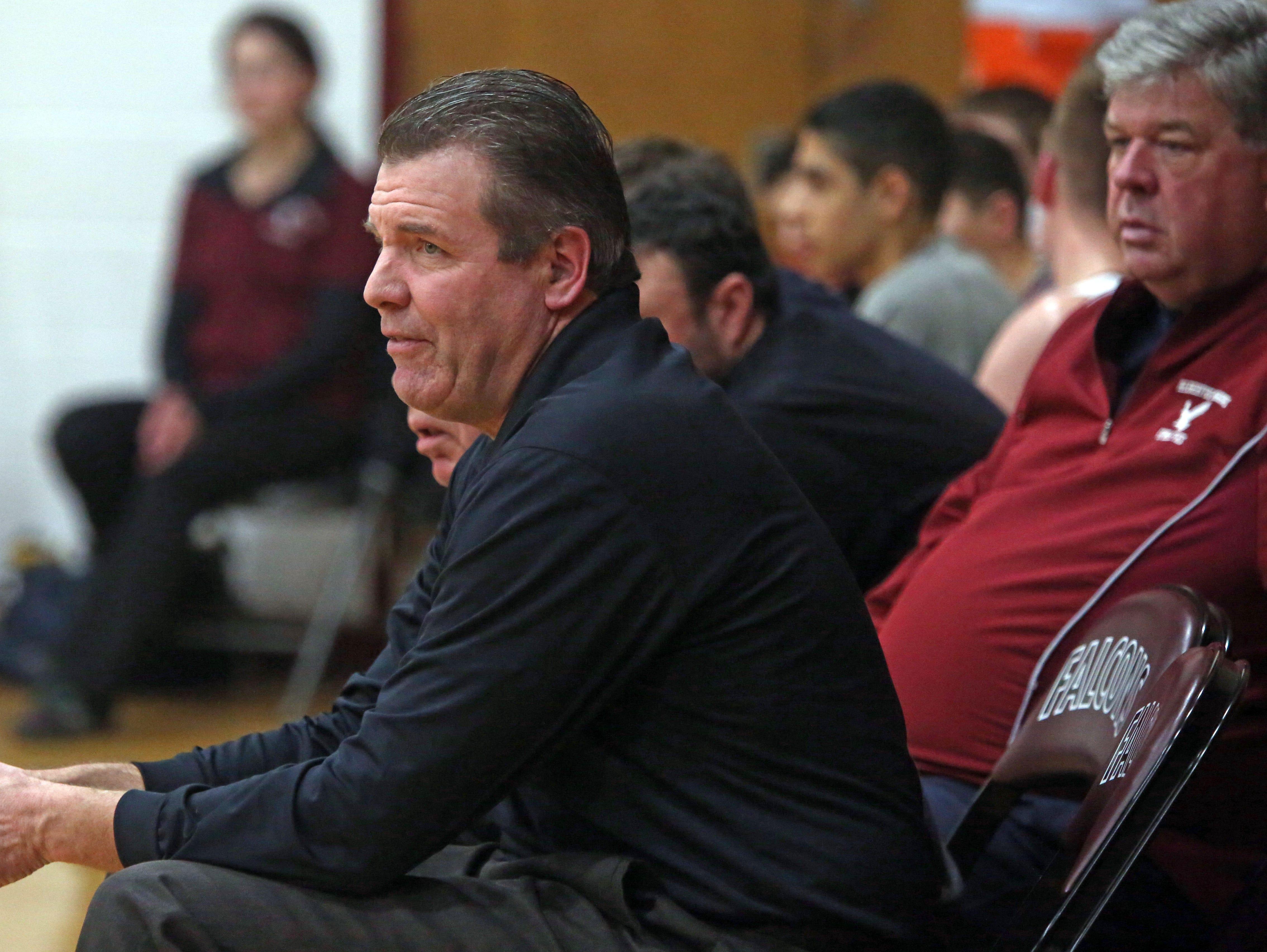 Albertus Magus head coach Patrick McFadden watches his team play Riverside during boys basketball game at Albertus Magnus High School Feb. 12, 2016.
