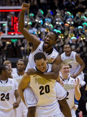 A.J. Hammons gave teammate Rapheal Davis a ride after Purdue beat Indiana this past season. Will the 7-foot center enjoy more memorable wins as a Boilermaker junior?