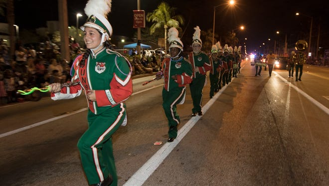 Members of the Dunbar High School marching band perform along U.S. 41 Saturday as part of the 80th Edison Festival of Light Grand Parade.