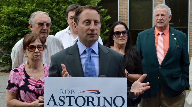 Westchester County Executive Rob Astorino speaks outside New Castle Town Hall on Thursday, calling on Gov. Andrew Cuomo to open his home to the New Castle assessor.