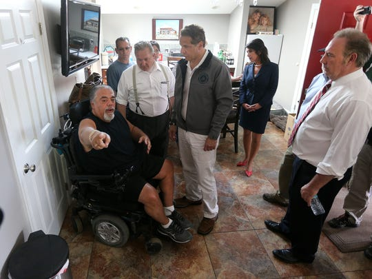 Edgemere Drive resident Joseph Burgio,  explains high water problems to New York State Governor Andrew Cuomo who visited Greece and announced $7 million for residential flood damage.