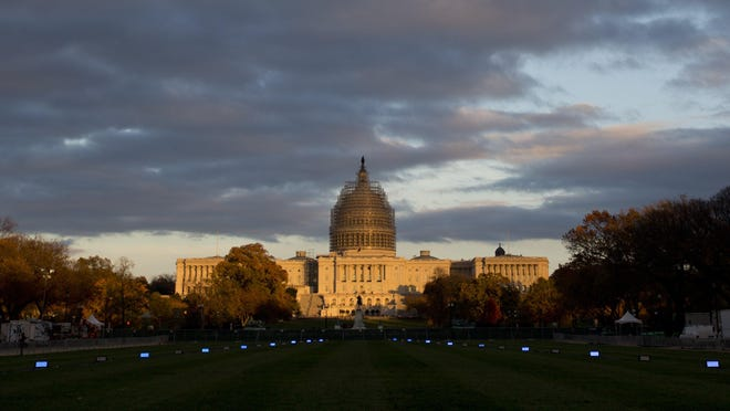 The U.S. Capitol Building illuminated by the setting sun on the National Mall in Washington.
