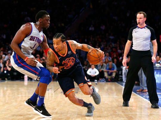 Mar 31, 2018; New York, NY, USA; New York Knicks guard Trey Burke (23) drives to the basket against Detroit Pistons guard Reggie Jackson (1) during second half at Madison Square Garden.