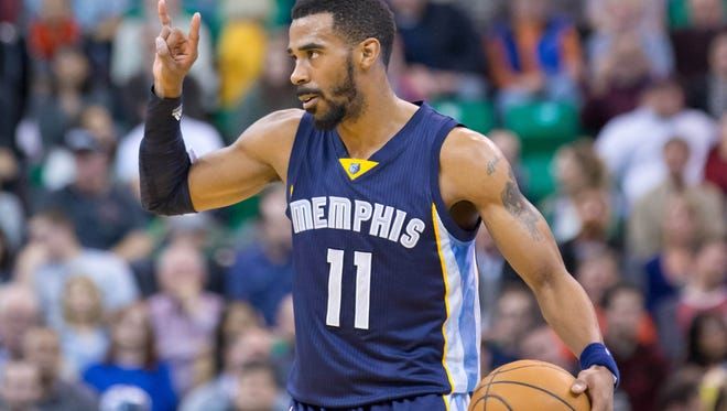 Mike Conley (11) agrees to stay with the Memphis Grizzlies.