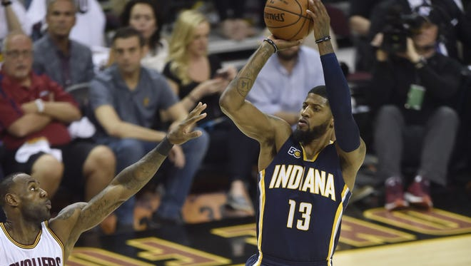 Indiana Pacers forward Paul George shoots against Cleveland Cavaliers forward LeBron James in the first quarter in game one of the first round of the 2017 NBA Playoffs.