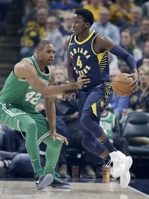 Indiana Pacers guard Victor Oladipo (4) looks to drive on Boston Celtics forward Al Horford (42) in the first half of their game at Bankers Life Fieldhouse Monday, December 18, 2017.