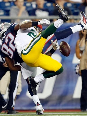 Green Bay Packers cornerback Quinten Rollins (24) breaks up a pass intended for New England Patriots wide receiver Josh Boyce (82) during the first half of an NFL preseason football game Thursday, Aug. 13, 2015, in Foxborough, Mass.  (AP Photo/Michael Dwyer)