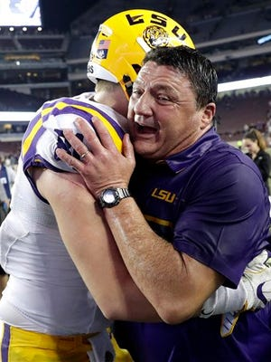 LSU head Ed Orgeron, right, is hugged by tight end Colin Jeter  after an NCAA college football game against Texas A&M Thursday, Nov. 24, 2016, in College Station, Texas. LSU won 54-39. (AP Photo/David J. Phillip)